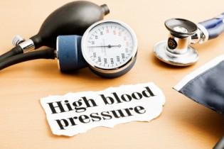 Stethoscope, blood pressure gauge and hypertension headline