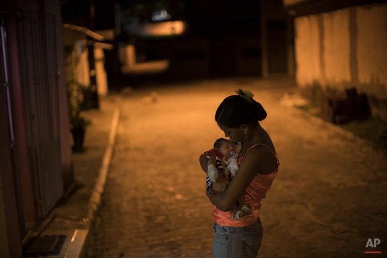 Jan. 26, 2016 photo, Daniele Ferreira dos Santos and her son